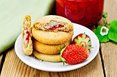 Biscuits With Strawberries And Jam On The Board