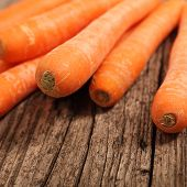 Close-up Of Fresh Carrots On A Wooden Table