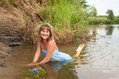stock photo of undine  - Blonde girl in flower chaplet at river - JPG