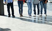 Low section of college students standing in a row on university campus