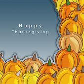 Happy Thanksgiving Day concept with pumpkins on grey background, can be use as flyer, poster or banner,