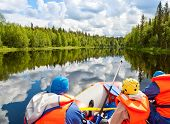 picture of raft  - Rafters in a rafting boat on Pistojoki river in Karelia - JPG