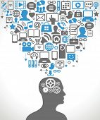 Silhouette of a human head with gears in place of the brain. Above his head is a lot of icons.  Social network, communication in the global computer networks.