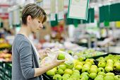 Woman Choosing Apple At Fruit Supermarket