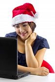 picture of long distance relationship  - young Asian female working or on a webcam chat during Christmas - JPG