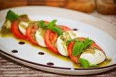 Caprese salad with sause Pesto