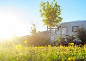 stock photo of camper-van  - View of Camping site in the morning sun - JPG