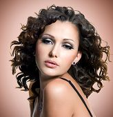 Face Of  Beautiful Adult Woman With Curly Hairs
