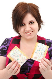 pic of teenage girl  - Beautiful seventeen year old teen girl holding two toaster pastries - JPG