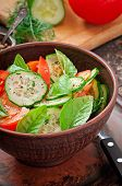 stock photo of lenten  - Tomato and cucumber salad with black pepper and basil - JPG