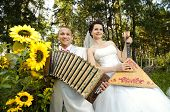 image of accordion  - fiancee blow the balalaika bridegroom play on accordion wedding humour photo - JPG
