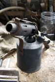 picture of blow torch  - Old Blow lamp on workbench parafin blow torch for removing paint - JPG