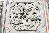 Facade of a stone carving of a dragon