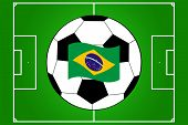 vector of football field and ball with waving flag of Brazil