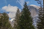 stock photo of granite dome  - Yosemite National Park granite cliffs rivers waterfalls domes and the beautiful landscape formed by glacier - JPG