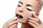 Makeup with rhinestones and manicure.