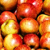 Pile Of Apples In A Market Stall. Red Apples Background. Food Background.