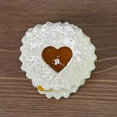 picture of linzer  - Linzer cookie with apricot jam heart. Food theme.