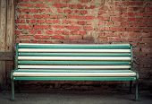 Beautiful Multi-colored Bench At A Brick Wall