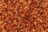 Dried Chilli Flakes And Seeds Abstract Background Texture