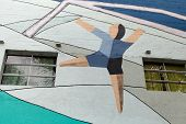MONTEVIDEO, URUGUAY - MAR 19 2014 : A footballer mural on the exterior wall of the Centenario Stadiu