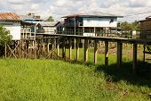 Houses On Stilts Rise Above The Polluted Water In Islandia Peru