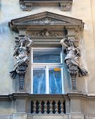 picture of muse  - Window Art Nouveau building is decorated by statues of the goddess muse of the theater and the huntress - JPG