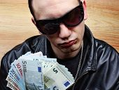pic of stolen  - Chief boss mafia gangster thug with stolen money euro - JPG