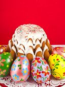 easter bread cake and colored egg on red background