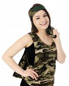 A beautiful teen girl in a camouflage shirt and headband, and a jacket slung over her shoulder.  On