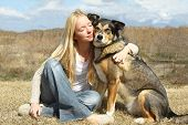 Woman Hugging German Shepherd Dog Outside