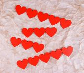 Paper hearts on paper background