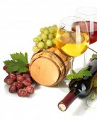 barrel, bottle and glasses of wine and ripe grapes isolated on white