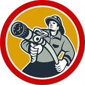 stock photo of firemen  - Illustration of a fireman fire fighter emergency worker aiming a fire hose viewed from front set inside circle done in retro style - JPG