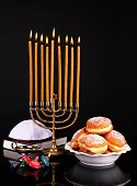 Festive composition for Hanukkah isolated on black