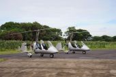 stock photo of gyrocopter  - Two autogyros landed on the small rural airdrome - JPG