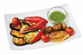 Grilled vegetables cucumbers tomatoes onions and peppers on an isolated background