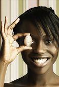 Headshot of woman holding egg