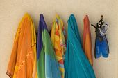Still life of beach towels on hooks