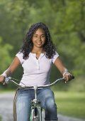 Teenage girl riding a bike