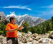 picture of himachal pradesh  - Hiker trekker studying map route on trek in Himalayas mountains - JPG