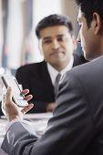 Businessman using a PDA in restaurant