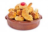 an earthenware bowl with panellets, typical pastries of Catalonia, Spain, eaten in All Saints Day, on a white background