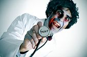 a scary zombie doctor with the word fear written in his stethoscope