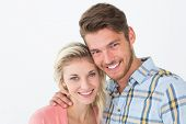 Close up portrait of young couple over white background