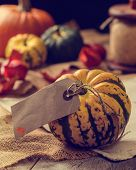 Thanksgiving table setting with pumpkins and autumn leaves