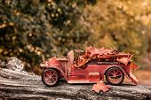 picture of logging truck  - Vintage red truck carrying autumn leaves  - JPG