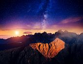 image of meteorite  - Cadini di Misurina range and Sorapis group under starry light in Natural park Tre Cime di Lavaredo - JPG
