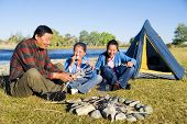 stock photo of mongolian  - Mongolian family anjoy camping by the river - JPG