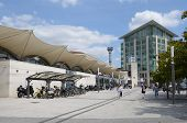 POITIERS, FRANCE - JUNE 26, 2013: People and bike parking in front of the train station. The station is situated on the Paris Bordeaux railway which was built in 1853